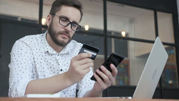 Thumbnail for Man Paying Online By Bank Card at Smartphone