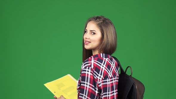 Thumbnail for Gorgeous Cheerful Female Student Smiling Over Her Shoulder