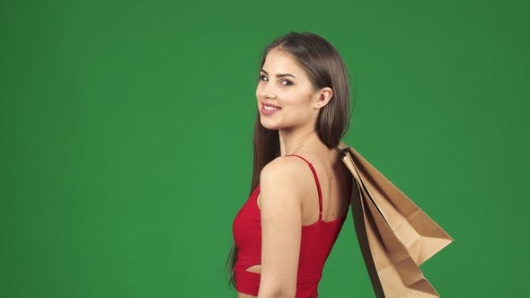 Thumbnail for Happy Beautiful Woman Smiling Holding Shopping Bags Showing Thumbs Up