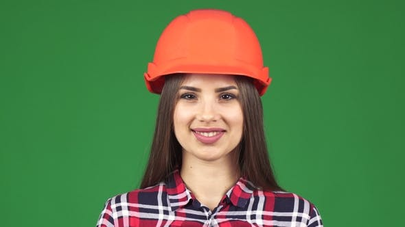 Cover Image for Sexy Beautiful Female Constructionist Smiling Wearing Hardhat