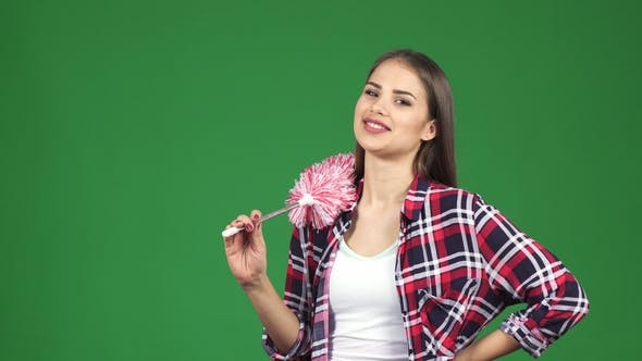 Thumbnail for Young Beautiful Housewife Smiling Holding a Duster on Chromakey Background
