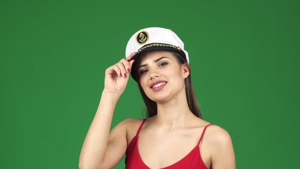 Thumbnail for Beautiful Young Sexy Woman Smiling Joyfully Wearing Sailor Cap on Green Screen