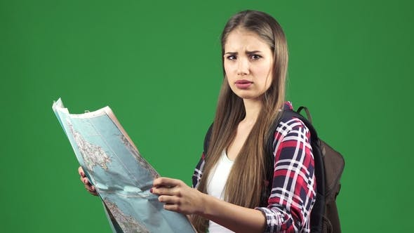 Thumbnail for Beautiful Young Female Tourist Looking at the Map with a Confused Expression