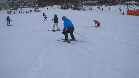 Thumbnail for Skiers Sliding Down on Snowy Hill and Enjoying Travel in Resort