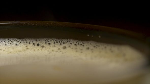 Thumbnail for Coffee Foam Isolated Over a Black Background