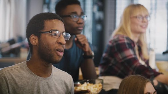 Thumbnail for Multi Ethnic Young People Watch TV at Home
