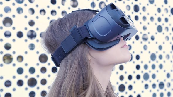 Woman Using a Virtual Reality Headset on White Futuristic Background. Young Attractive Woman Using