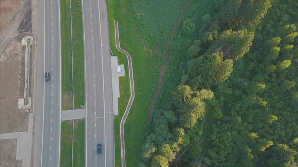 Thumbnail for Highway Road Between Trees. Aerial View of Truck Driving at Highway Road at Green Forest
