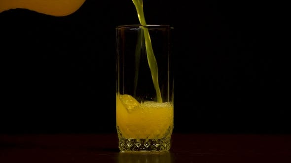 Thumbnail for Orange Soda Large Glass, Overflowing Glass of Orange Soda  with Bubbles Isolated
