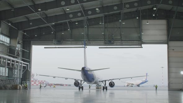 Thumbnail for Airplane Parking in the Airport Hangar. Airplane in Hangar, Rear View of Aircraft and Light From