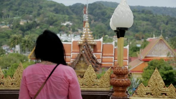 Cover Image for Brunette Female Tourist Is Observing Fascinating Asian Landscapes at the Viewpoint.