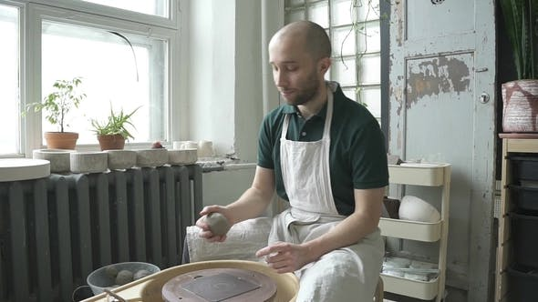 Thumbnail for Portrait of Male Ceramist, Who Is Starting His Work in Bright Studio