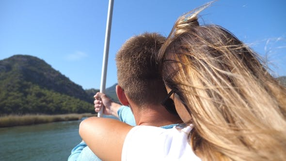 Thumbnail for Young Couple Spending Time Together on Deck of Sailboat at Sunny Say. Girl Hugging Her Boyfriend