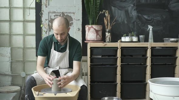 Thumbnail for Male Ceramist, Who Is Working on Mug in Bright Studio.
