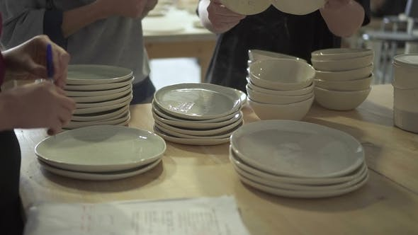 Thumbnail for Young Workers Is Looking at Plates in Ceramic Workshop.