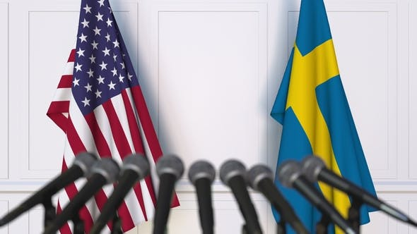 Thumbnail for Flags of the USA and Sweden at International Press Conference