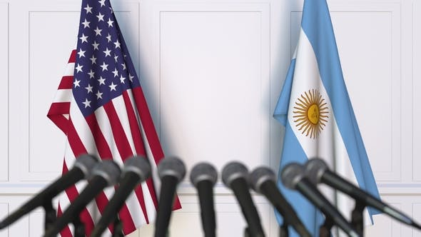 Flags of the USA and Argentina at International Press Conference