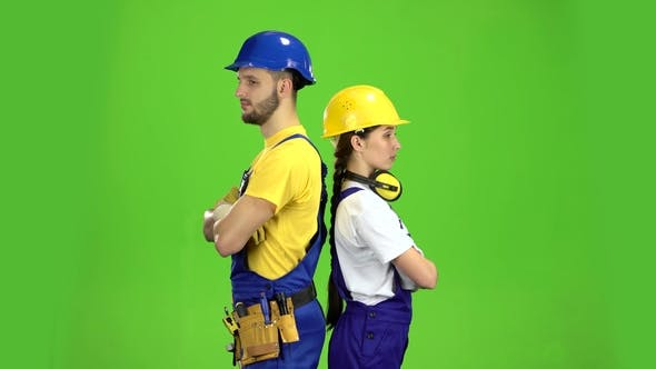 Cover Image for Two Builders Stand Back To Back and Point with Their Fingers Straight