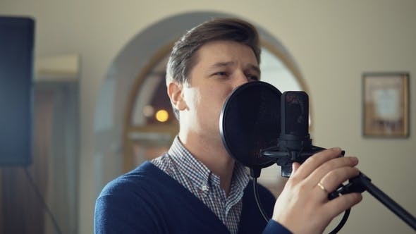 Thumbnail for a Man Sings Into a Studio Microphone