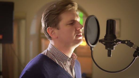 Thumbnail for Man Sings Into a Studio Microphone