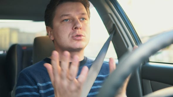Thumbnail for A Young Attractive Man Is Driving a Car and Swearing