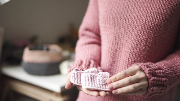 Thumbnail for Female Hands Holding Baby Booties Knitted Shoes Handmade for Children