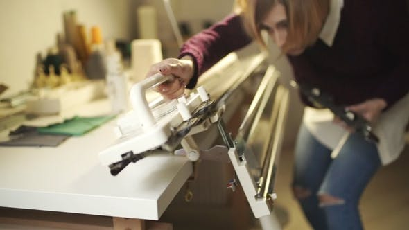 Thumbnail for Young Woman Adjust Knitting Machine for Working in Home Workshop