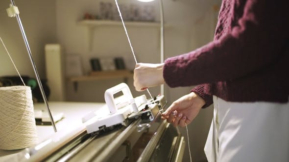 Thumbnail for Creative Woman Preparing Weaving Machine for Work in Textile Workshop