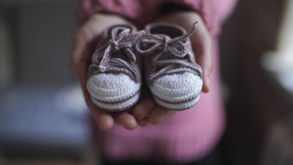 Thumbnail for Female Hands Showing Baby Booties Knitted Shoes for Children