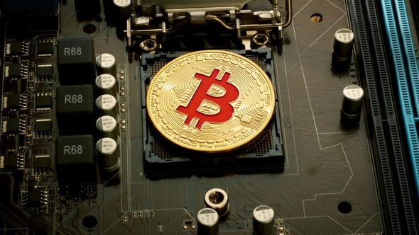 Thumbnail for Gold Bit Coin BTC Coins on the Motherboard Bitcoin Is a Worldwide Cryptocurrency