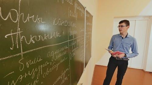 High School Student Answers at the Blackboard. School Theme.