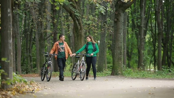 Thumbnail for Couple Together Ride A Bicycle