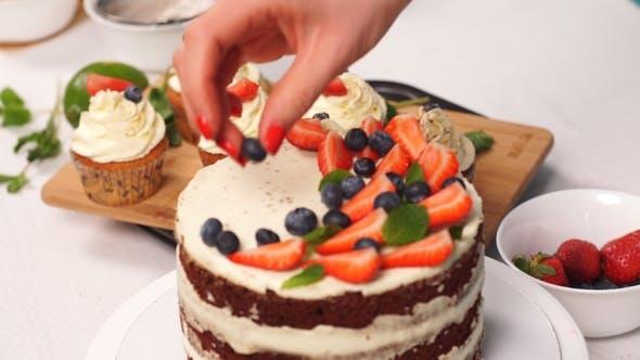 Chef Confectioner Decorates Cake. Modern Cake.