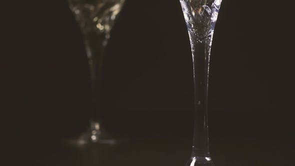 Thumbnail for White Wine Flows Into the Wine Glass. The Camera Rises.