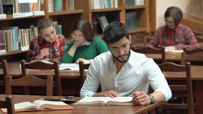 Students Revise for Exam in Library