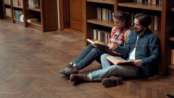 Thumbnail for Teens Read Books on Floor