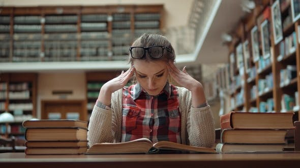 Thumbnail for Tired Student in Library