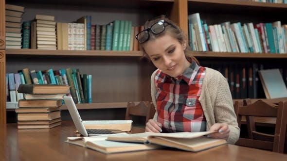 Thumbnail for Girl at Library Table