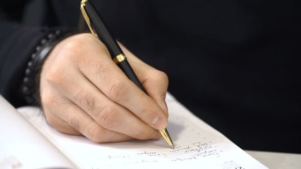 Thumbnail for Businessman Is Writing Something in Planner