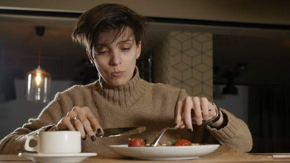 Thumbnail for Woman is Eating Vegetables in Cafe
