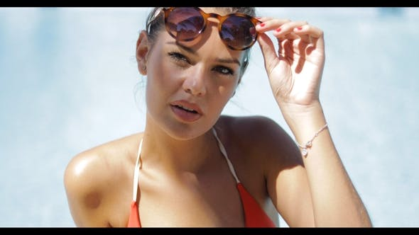 Cover Image for Sensual Girl in Sunglasses and Bikini
