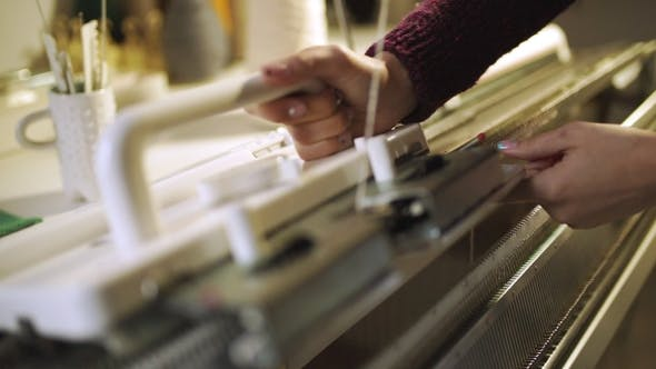 Thumbnail for Creative Woman Making Knitted Texture on Weaving Machine in Workshop