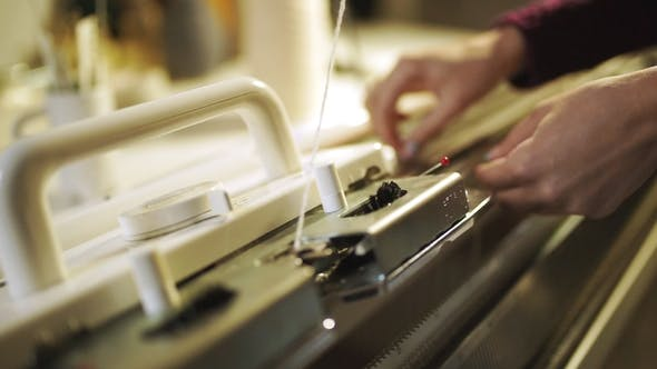 Thumbnail for Woman Knitter Hand Working on Weaving Machine Knitting Machine Production