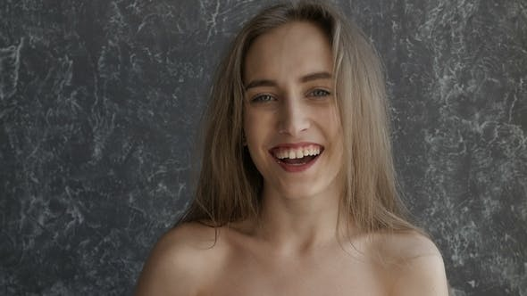 Thumbnail for Naked Attractive Girl is Laughing