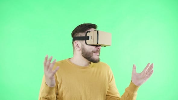 Thumbnail for Man Enjoy in Cardboard Google VR Headset for Phone