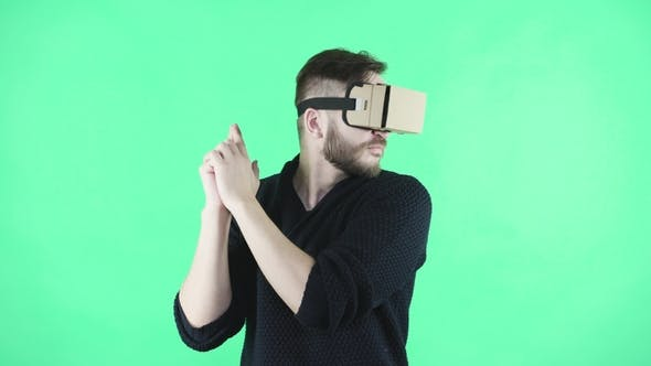 Thumbnail for Man in Vr Headset on the Green Background
