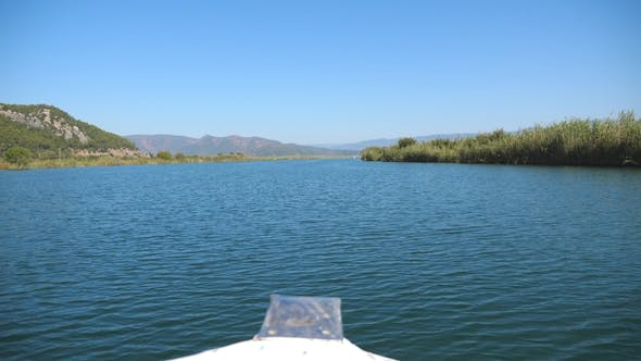 Thumbnail for Beautiful View From the Bow of Moving Ship Along Bay on Sunny Day. Sailboat Floating on River