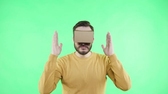 Thumbnail for Man in Vr Glasses Enjoy on the Green Background