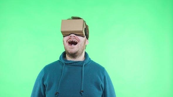 Thumbnail for Man Enjoy in Cardboard Google VR Headset for Phone