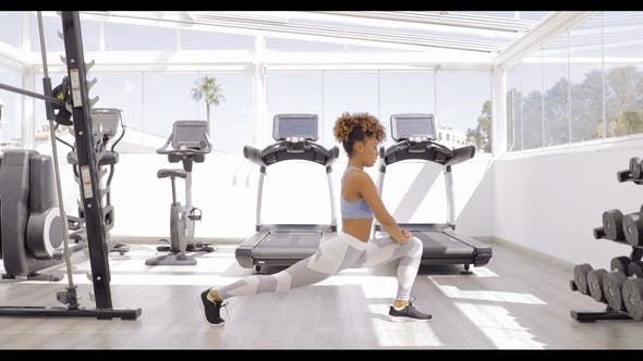 Thumbnail for Woman Stretching Legs in Gym